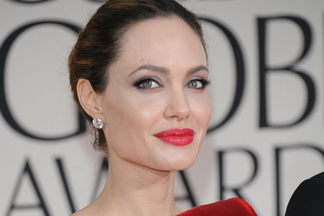 "Angelina Jolie is telling a ""select group of people"" she is pregnant, ..."