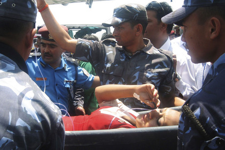 Plane 2012 on An Injured Air Hostess Is Taken For Treatment Following The Crash