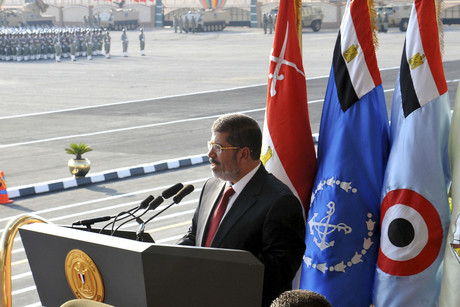 Egypt's new president Mohammed Morsi delivers a speech during a cermony where the military handed over their power to him (reuters)