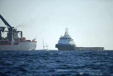 A flotilla of protest ships has been surrounding Anadarko's Noble Bob Douglas about 100 na
