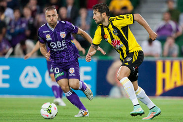 Vince Lia controls the ball for the Phoenix against Perth Glory (AAP)
