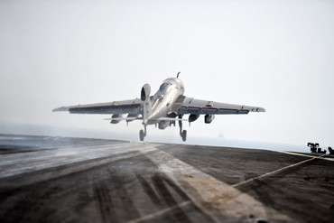 A US Navy F/A-18 takes off from aircraft carrier USS George H W Bush in the Persian Gulf (AAP file)